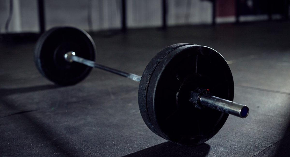 Closeup of barbell on gym floor