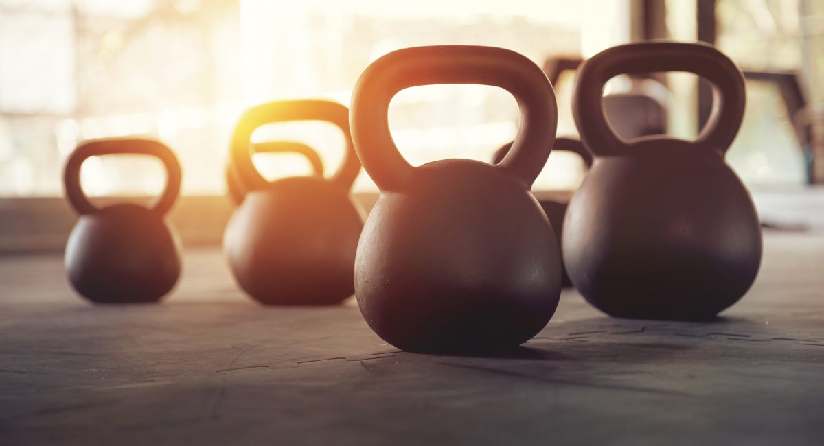 Sport equipment in gym. kettlebell on floor background and sunlight. Fitness training