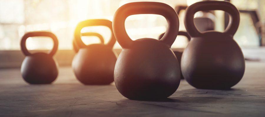 Sport equipment in gym. kettlebell on floor background and sunlight. Fitness training